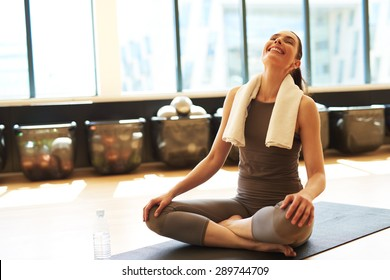 Fit satisfied woman after her pilates class