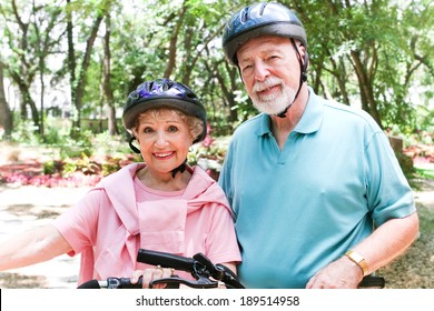 Fit senior couple rides bikes to stay in shape.