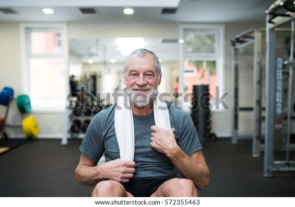 Fit senior man resting after working out.