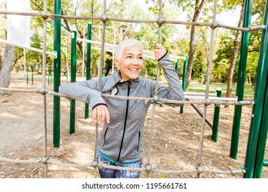 Fit Senior Woman Exercise At Outdoor Gym, Sports Clothes, Sporty Mature Female With Short Hair, Healthy Lifestyle.