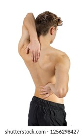 Fit shirtless caucasian young adult with back pain