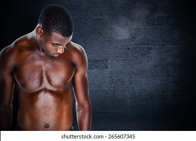 Fit shirtless young man against black background