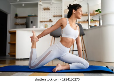 Fit sport woman exercising and training at home
