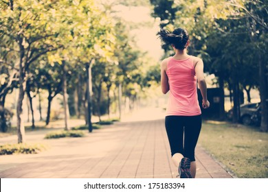 fit sports woman jogging at park