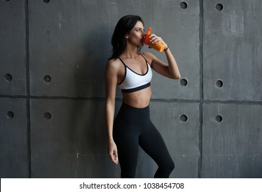 fit sporty woman drink protein cocktail - sportive nutrition