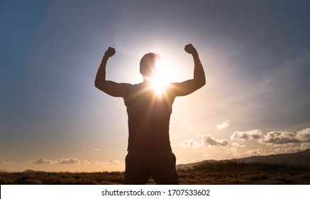 Fit, strong , healthy young man flexing on a mountain. People healthy active lifestyle concept.