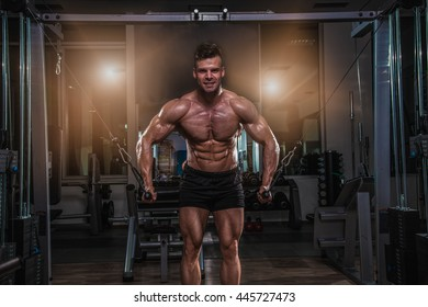 Fit strong man in gym.