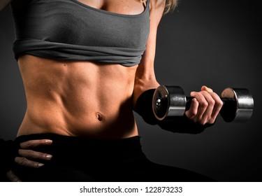 Fit woman abdomen muscle definition
