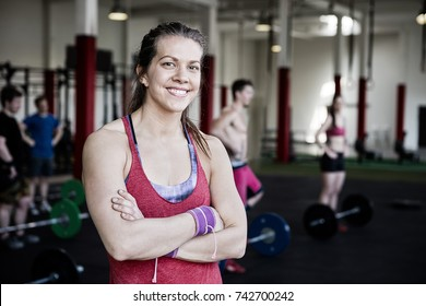 Fit Woman With Arms Crossed Standing In Fitness Center