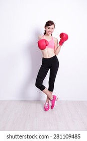 Fit woman boxing with health, attractive and slender figure, with white wall great for your design or text, asian beauty