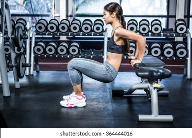 Fit woman doing fitness exercises at the gym