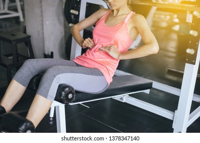 Fit woman doing situp or crunches in gym,Female exercise muscular her stomach
