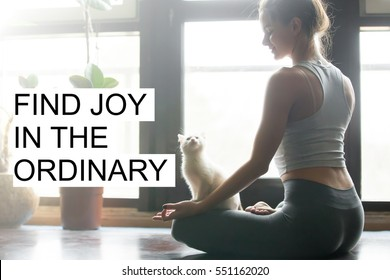 """Fit woman doing yoga or pilates exercise with white kitty. Fitness motivation quote with motivational text """"Find joy in the ordinary"""". Healthy lifestyle concept"""