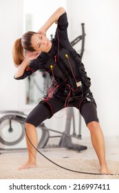 fit woman exercise on electro muscular
