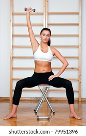 fit woman in fitness salon exercise with weights
