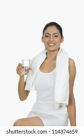 Fit woman holding a glass of water