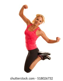 fit woman jumps over white background as a gesture of success.