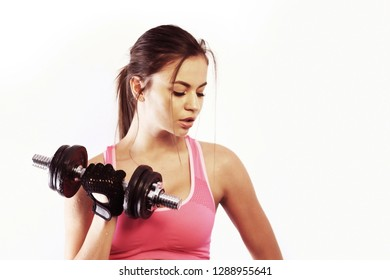 Fit woman lifting a dumbbell. Isolated on white