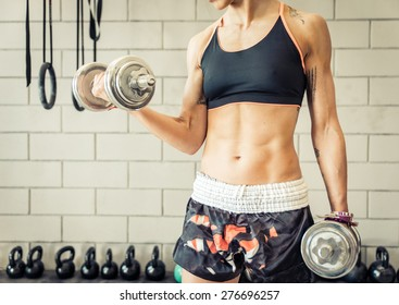 fit woman making biceps training. concept about workout,gym,fitness and people