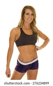 A fit woman posing and showing off her fit body.