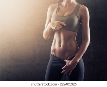 Fit woman showing her perfect abs