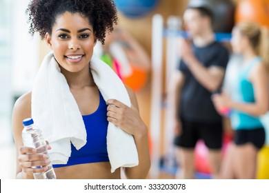 Fit woman smiling at camera at the gym