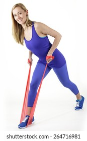 Fit woman stretching rubber stretch band - isolated over white background