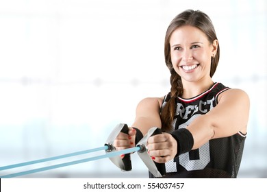 Fit woman working out with elastic bands