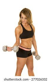 A fit woman working out her arms, with weights.