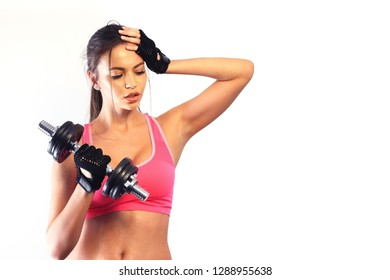 Fit woman working out. Isolated on white