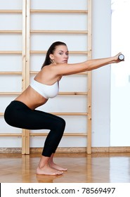 fit woman workout with weights in fitness studio