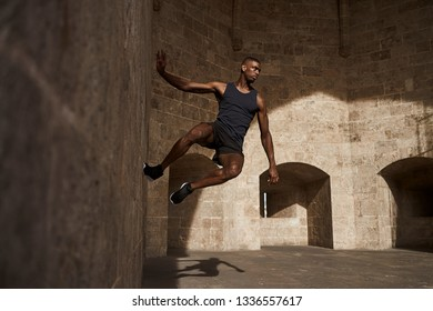 A fit young man runs and works out in various locations around the Spanish city of Valencia.