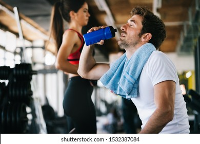 Fit young man taking break from working out