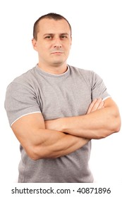 Fit young man with t-shirt and arms crossed isolated on white background