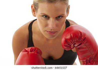 Fit young woman with red boxing gloves