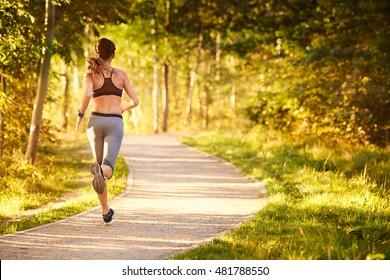 Fit young woman running in park
