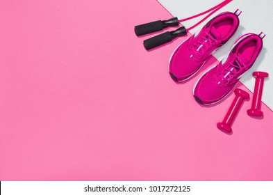 Fitness accessories, healthy and active lifestyles concept background with copy space for text. Products with vibrant, punchy pastel colours and frame composition. Image taken from above, top view.
