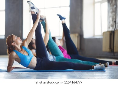 Fitness, active lifestyle, perfect shape, flexibility, yoga, pilates. Group women workout performing static stretching exercise