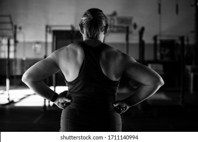 Fitness at any age. woman 55+ at gym, lifting weights.