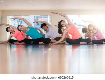Fitness Asian woman at stretching training at gym fitness center. Young slim girl makes aerobics exercise.Yoga Practice Exercise Class Concept