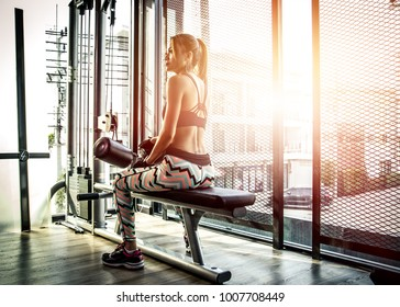 Fitness Asian woman working out shoulder pull down at gym. Girl strength training using lat pulldown machine