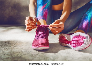 Fitness athletes foot close-up. Healthy lifestyle and sport concepts. Woman in fashionable sportswear is doing exercise.