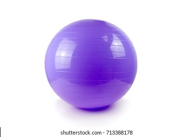 Fitness ball and pilate against a white background