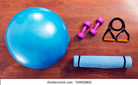 fitness ball, yoga mat and dumbbells top view