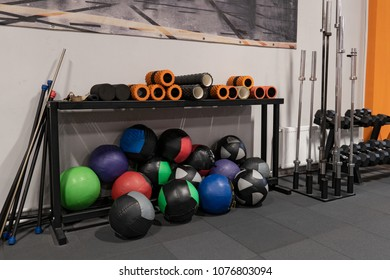 Fitness balls and rods on the floor in the gym for workout