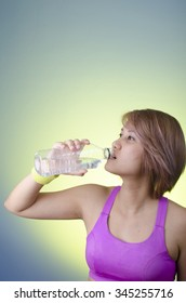 Fitness beautiful woman drinking water and sweating after exercising