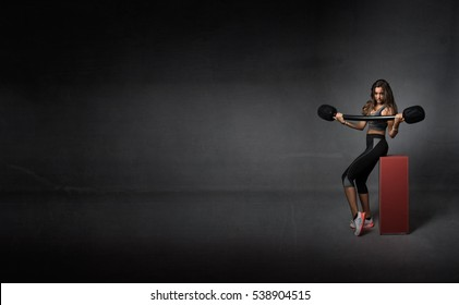 fitness body weights in dark background