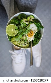 Fitness Breakfast Buddha Bowl with Active Wear - Women Holding a Breakfast Bowl