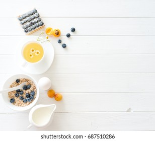 Fitness breakfast: granola with berries and fruits, eggs and tea.