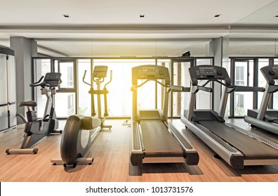 Fitness center interior with fitness machine with morning light.